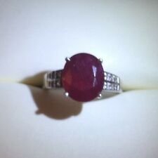 Size 8 Natural Ruby solitaire ring (6.55 ct) with 16 round white topaz accents.