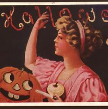 PRETTY LADY PLAYS HALLOWEEN APPLE PEEL SUPERSTITION, JOL,WALL,1910 POSTCARD
