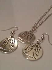 Gardian angel hook earrings and necklace matching et inscribed on the reverse