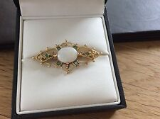 9ct Gold brooch set with large oval Opal & 6 Emerald stones