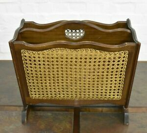 Antique style bergere cane and carved magazine rack