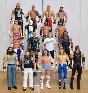 Set of 4 WWE wrestling figures inc. Roman Reigns, Braun Strowman & The Rock