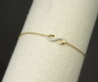 Infinity Bracelet with 1pc Natural Diamond in 9K Yellow Gold & Gold Chain