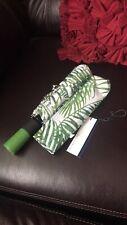 Dooney & Bourke Siesta Key Umbrella -leaves-green white background with D&B