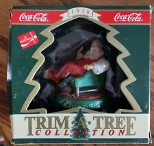 coke coca cola 1958 santa relaxing in a chair with a fawn underneath