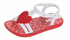 Chaussures rouges en caoutchouc pour bébé