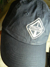 PORT AUTHORITY CAP WITH WHITE 'INTERNATIONAL' EMBLEM EMBROIDERED ON NAVY BLUE