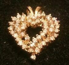 14k diamond heart pendant 4.8 grams  w diamonds set w 49 diamonds apx 1 carat+!!