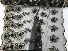 BLACK/GOLD 3D FLORAL DESIGN WITH PEARLS ON A MESH LACE-SOLD BY YARD.