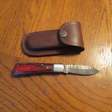 Damascus folding blade knife with multi color laminated handle & leather sheath