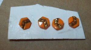 4 orange glass buttons with gold detail