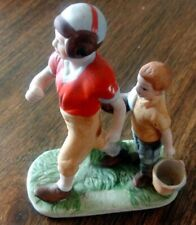 Norman Rockwell football player figurine with waterboy