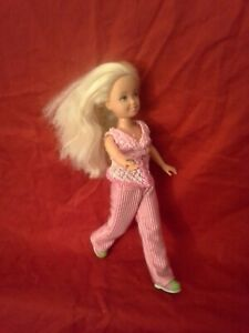 MATTEL BARBIE KELLY DOLL IN PINK OUTFIT (ROUND METAL IN RIGHT HAND) SEE IMAGES