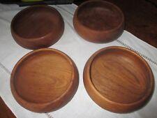 4 Primitive wooden bowls.Matching