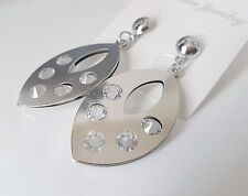 Gorgeous small silver tone oval shape drop earrings with cut out crystal detail
