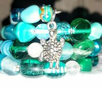 New Memory Wire Wrapped Bracelet. Made with Blue, Green & Aqua Tones Glass Beads
