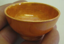 Early 20th century miniature orange luster Moorcroft bowl