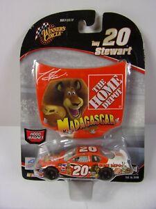 NIB 2005 WINNER CIRCLE TONY STEWART #20 MADAGASCAR W/HOOD & 1/64 DIE CAST W/WEAR