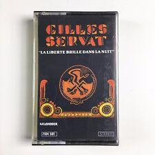 GILLES SERVAT - LA LIBERTE BRILLE DANS LA NUIT - Cassette 7104501 - FRENCH K7