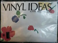 """70"""" Round Vinyl Ideas Flannel Backed Tablecloth White w/ Floral Red Blue Yellow"""