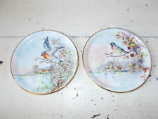 Vintage Limoges plates with birds and country scenes good condition