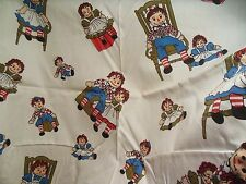 Raggedy Ann and Andy Fabric Dolls Sitting on Box In Chair White Background 1/2 Y