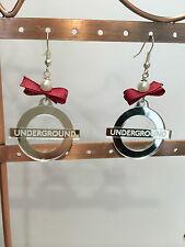 Orecchini Plexiglass con simbolo underground specchietto argento fiocco porpora
