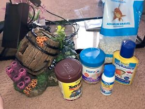 5gal Fish Tank + 1/2 gal Fish Tank. Filter, food, and water cleaner included