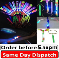 12 SlingShot Arrow Rocket Copters LED Light Helicopter Flying Elastic Toy FASTUK