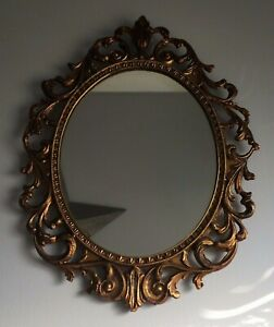 VINTAGE DECORATIVE AGED GILT METAL ORNATE ROCOCO STYLE OVAL WALL MIRROR