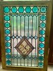 22 blue roundels with painted and fired joker and serpent  stained glass window