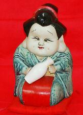 Otafuku doll (an attractive girl despite plain woman) of Arita pottery in Japan