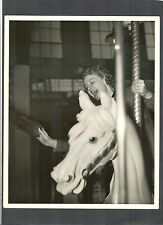 ANN SHERIDAN ON CAROUSEL HORSE GRABS FOR GOLD RING - 1937 PHOTO BY CRAIL