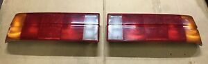 BMW e30 early model tail lights set left & right used W/ back covers