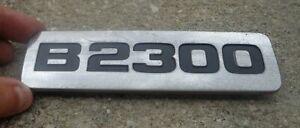 Mazda B2300 fender emblem badge decal logo symbol side OEM Genuine Original