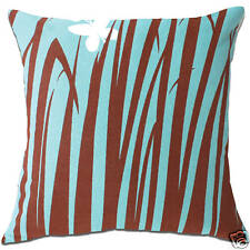 bulrushes reeds plants grass blue and brown cushion covers