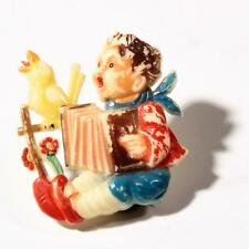 Vintage Bohemian Art Deco early plastic boy bird accordian figural pin brooch