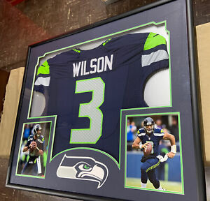 Seattle Seahawks Russell Wilson Framed & Matted Blue Jersey w/Pictures ManCave