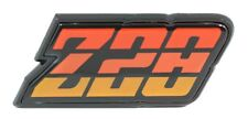 1980 - 1981 CAMARO Z28 REAR FUEL DOOR TAIL LIGHT PANEL EMBLEM - 3 COLOR - ORANGE