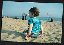 Cool Photograph Adorable Little Baby From Behind Sitting on the Beach