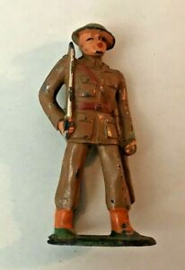 BARCLAY MANOIL LEAD SOLDIER: SOLDIER STANDING AT THE READY W SWORD  TOY #708