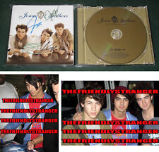 "Rare JONAS BROTHERS signed ""LINES VINES TRYING TIMES"" JAPANESE CD Proof Nick COA"