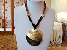 Brand new beaded necklace with a huge shell pendant in a gift bag