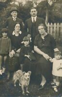 Dog and Seven People Real Photo Postcard rppc