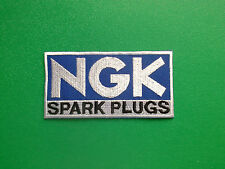 MOTOR RACING OILS, FUELS & TYRES SEW ON / IRON ON PATCH:- NGK SPARK PLUGS BLUE b