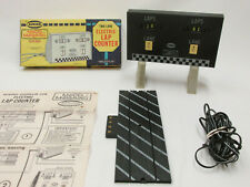 AURORA MODEL MOTORING ELECTRIC LAP COUNTER W/TRIP TRACK, SUPPORTS, & ORG BOX EXC