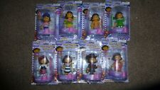DORA EXPLORES THE WORLD FIGURES COLLECTION OF 8 DOLLS INCLUDES VISA STICKER