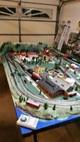 HO TRAIN LAYOUT WITH 3 DCC LOCOMOTIVES W/SOUND AND 7 DCC SWITCHES.