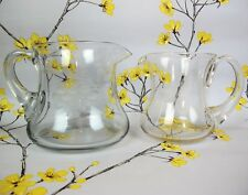 """Two vintage Clear Glass WATER / LEMONADE JUGS / PITCHERS. 5"""" and 4.5"""""""