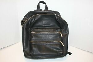 The Honest Company black faux leather baby bag backpack dust bag changing pad